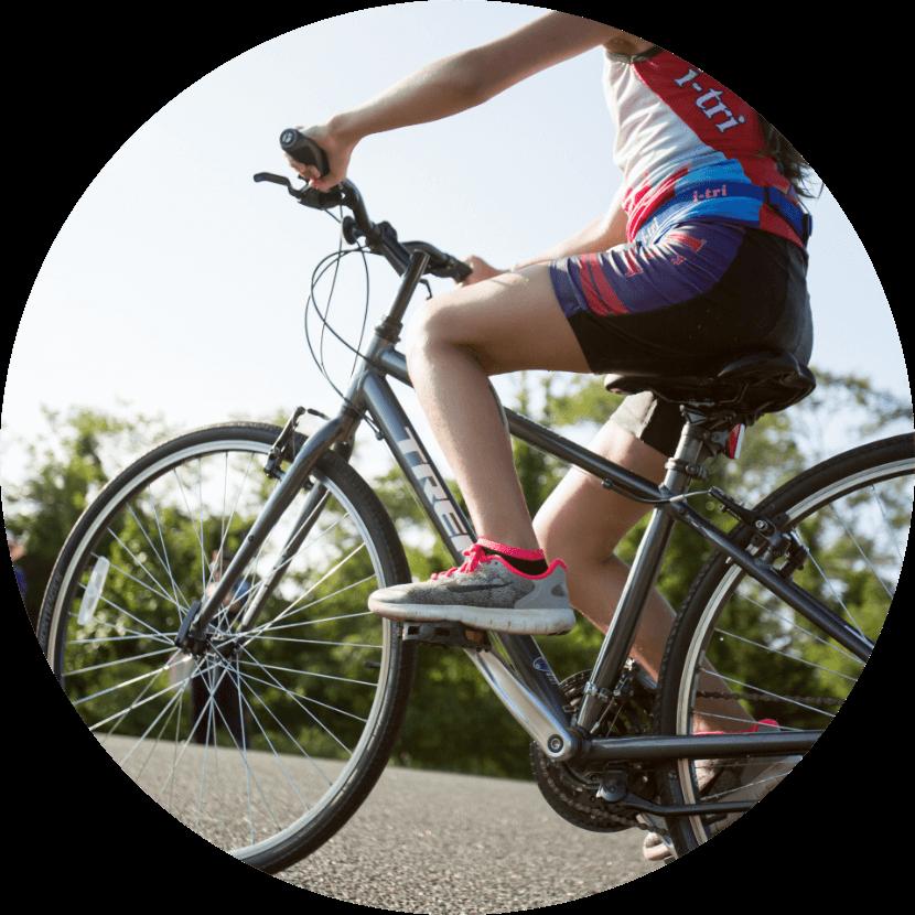 i-tri participant riding a bike